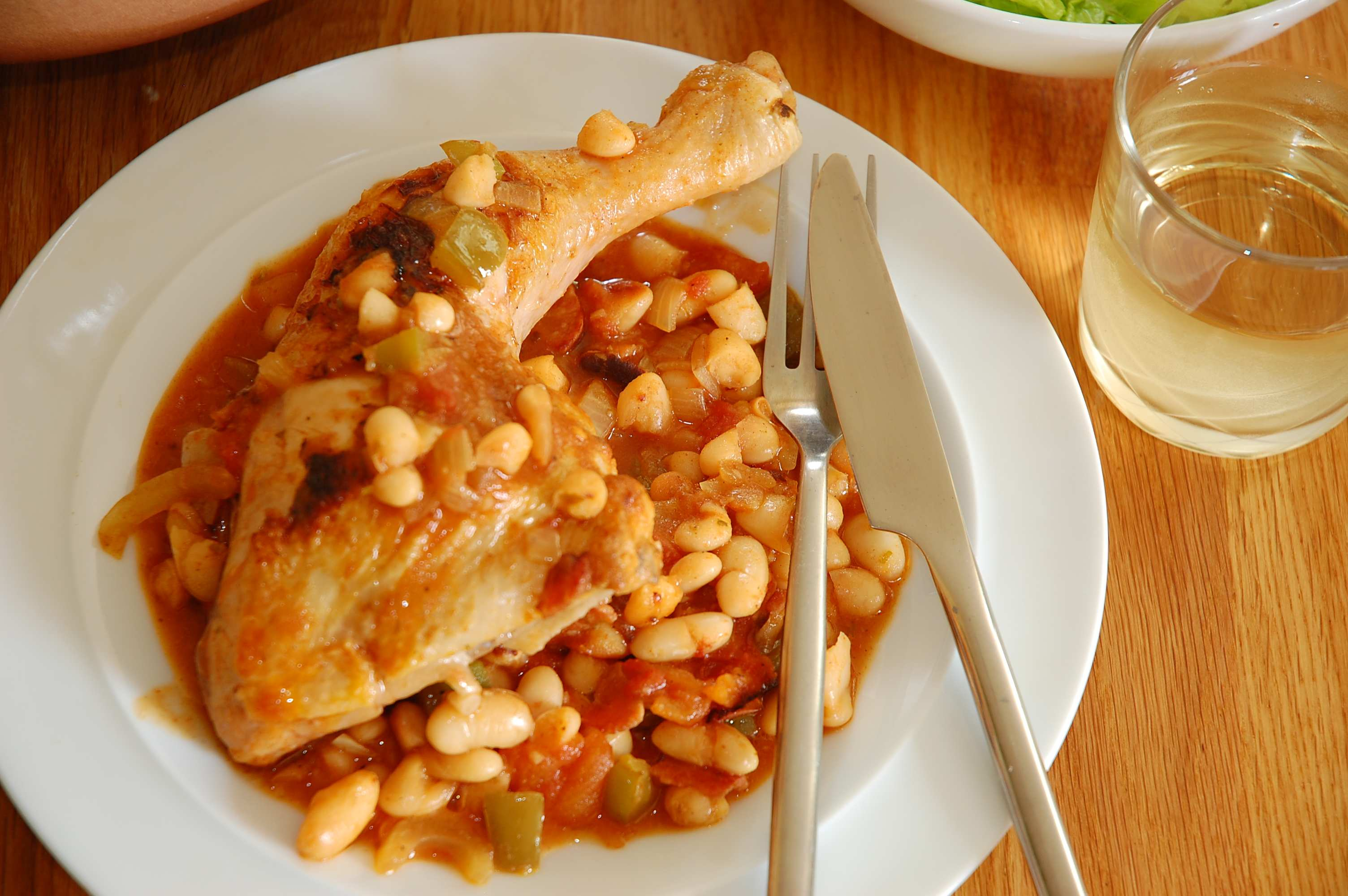 Bohemian chicken casserole with beans, paprika and bacon